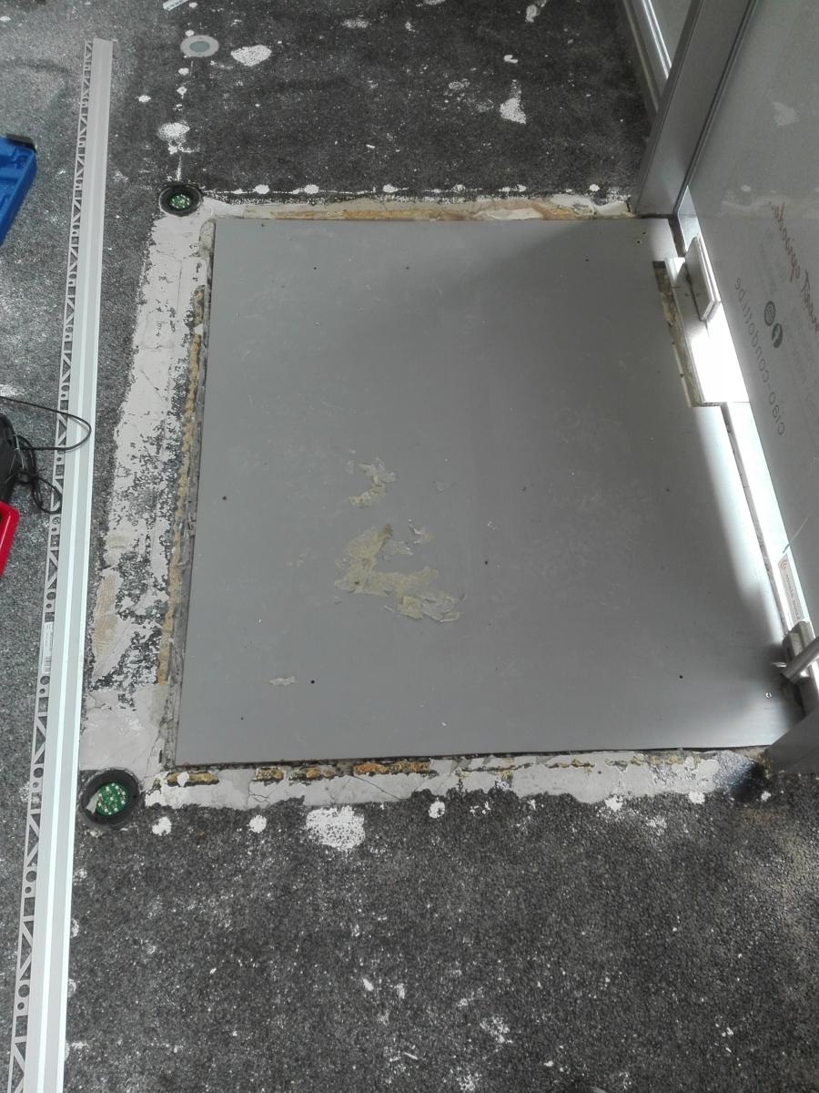 Steentapijt met ingewerkte deurmat